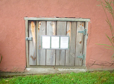 Before and after look of crawl space door