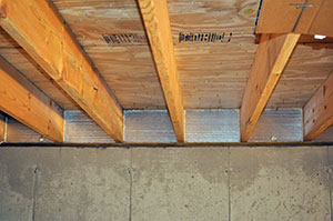 Insulating floors over a crawl space